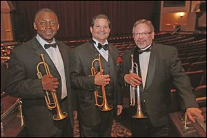 Trumpeters Dwight Adams, left, Patrick Hession, center, and Mike Williams.