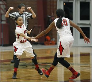 Rogers' Keyanna Austin, left, and Akienreh Johnson celebrate during their City League semifinal win Wednesday night.