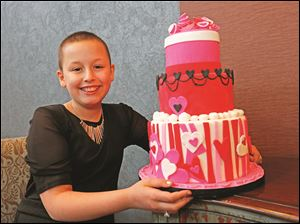 A little something Katie Secord, 11, of Toledo, whipped up with professional baker Wendy Kromer, of Wendy Kromer Confections of Sandusky, Ohio.