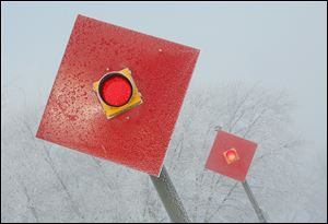 Red signals are a stark contrast to the fog and frost that envelop Cullen Park in Point Place.