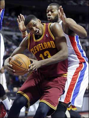 Cleveland's Tristan Thompson, who had 25 points, pushes back against Detroit's Greg Monroe.