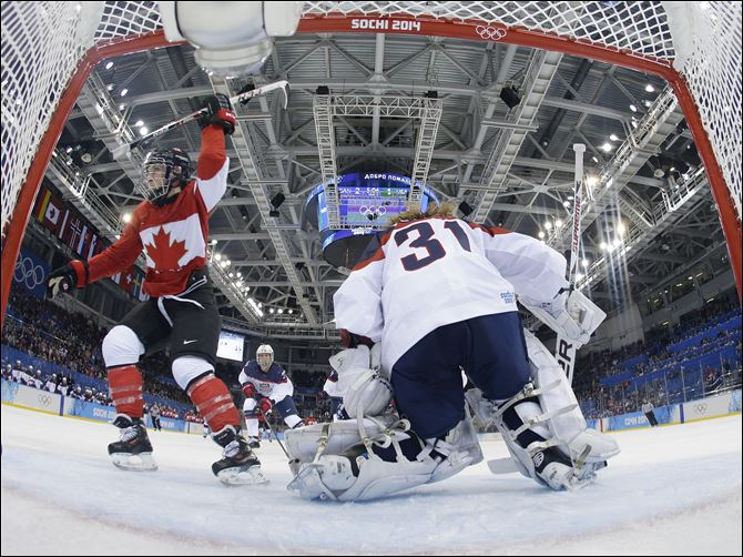 APTOPIX Sochi Olympics Ice Hockey Women Meghan Agosta-Marciano of Canada celebrates her second goal of the game against USA Goalkeeper Jessie Vetter during the third period in Sochi, Russia. Canada won 3-2 over the United States.
