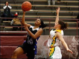 Woodward's Andrea Johnson drives in front of Start's Chelsie Randolph during City League semifinal.