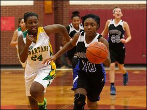 Start's Brittany McDuffie chases Woodward's Asieonna Alfred down the court.