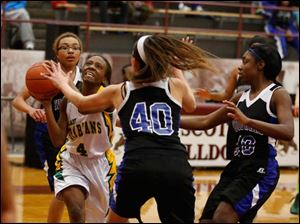 Start's Marquasia Turner is guarded by Woodward's Cierra Stamper (40), and Asieonna Alfred.