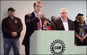 Ohio Democrat gubernatorial candidate Ed FitzGerald, left, is en-dorsed by Ken Lortz, right, UAW Region 2B director.