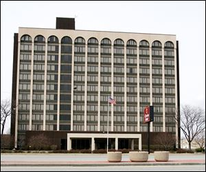 The city wants to acquire and demolish the shuttered Clarion Hotel on Reynolds Road to spur development.
