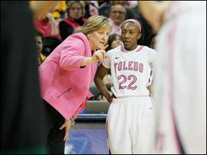 UT coach Tricia Cullop gives instructions to Andola Dortch on the sidelines in the second half.