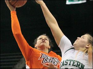 Bowling Green's Erica Donovan (21) puts up two points as Eastern Michigan's Olivia Fouty (33) attempts the block.