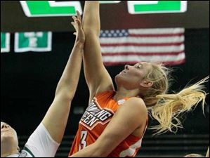 Bowling Green's Deborah Hoekstra (3) drives in for a layup over Eastern Michigan's Olivia Fouty (33).