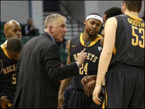 Toledo's head coach Tod Kowalczyk, center left, has a word with his team in a time out during the second half.