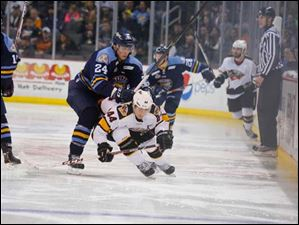 Toledo Walleye player Cincinnati Cyclones player during the second period.