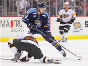 Toledo Walleye player Maxim Shalunov (29) makes a move on Cincinnati Cyclones player Taylor Aronson (4) before scoring a goal during the first period.