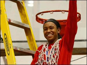 Rogers' Keyanna Austin wears the net after her team defeated Start.