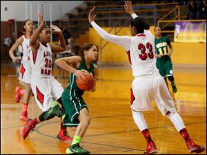 Start's Mariah White is surrounded by Rogers' Akienreh Johnson (30) and Marquelle Williams-Price.