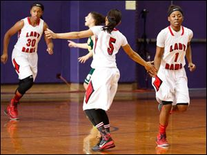 Rogers' Keyanna Austin high-fives Sasha Dailey.
