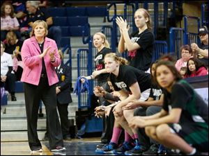 UT coach Tricia Cullop and her team applaud during the first half.