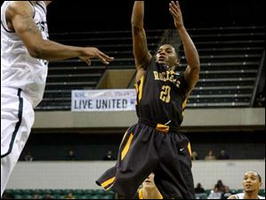 Toledo's Julius Brown (20) puts up two points during the second half.