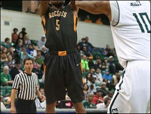 Toledo's Rian Pearson (5)  puts up two points over Eastern Michigan's Da'Shonte Riley (10).