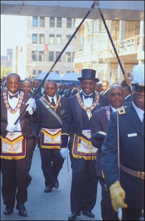 Grand Master James Willis, Sr., parades with fellow Masons in Toledo in 2006. He is also senior pastor of Toledo's St. Paul Missionary Baptist Church.