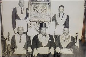 In a 1958 photograph at Amazon Lodge are, from left, J. Frank Troy, Clarence Walker, Jr., and James W. Ellis. Second row, from left, are W.W. Ballard and Carmen Williamson, who, after more than 60 years, is senior member of the Prince Hall Grand Lodge of Ohio, F&AM, in Toledo. Mr. Williamson says the lodge is the oldest chartered Masonic lodge, black or white, in Toledo. It is celebrating its 150th anniversary.