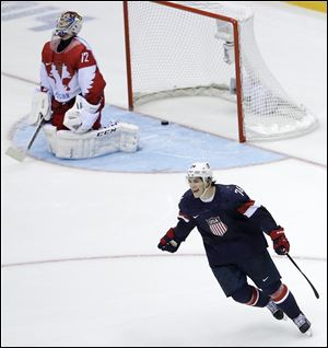 USA forward T.J. Oshie reacts after scoring the winning goal against Russia goaltender Sergei Bobrovski in a shootout.