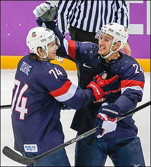 T.J. Oshie, left, is congratulated by Ryan Callahan after scoring the winning goal in a shootout win against Russia.