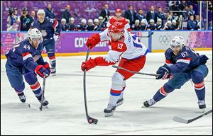 Russia's Pavel Datsyuk shoots the puck for his second goal of the game. He also scored in the shootout.