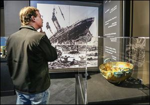Whitehouse resident Mark Reaume tours 'Titanic: The Artifact Exhibition' at the Imagination Station in Toledo. The 6,500-square-foot exhibit includes passenger belongings and re-created staterooms.