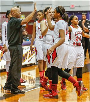 Rogers coach Lamar Smith high-fives Keasja Peace near the end of Saturday's City League championship game against Start. The Rams improved to 18-4.