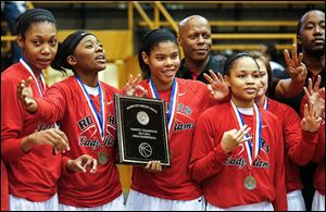 Tori Easley, left, Sasha Dailey, Jasmyne Smith, Rogers coach Lamar Smith, and Keyanna Austin celebrate their victory overs Start to win the City League girls basketball championship Saturday at Waite.