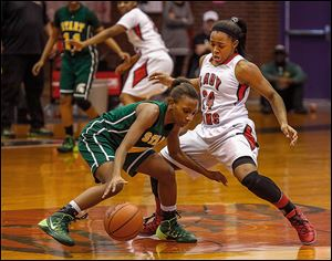 Start's Marquasia Turner is guarded closely by Rogers' Brelynn Hampton-Bey in Saturday's game.