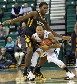 Toledo's Justin Drummond fouls Eastern Michigan's  Mike Talley. Drummond eventually fouled out.