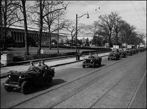 Photo shows the convoy that delivered the paintings, which had been stored in a German salt mine during World War II.  They were taken to the U.S. for safekeeping, where they went on a tour through museums in cities including Toledo, and later returned to Germany.