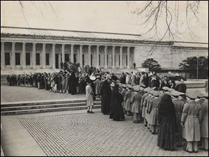 School students and Toledo residents wait in line outside  the Toledo Museum of Art to view more than 90 European paintings Nazis had buried deep in a German salt mine. In 1949, more than 100,000 people streamed into the museum in a 10-day exhibit of paintings.
