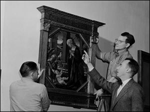 Otto Wittmann of the Toledo Museum of Art points at one of the paintings on display at the museum in 1949.
