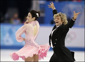 Meryl Davis and Charlie White of the United States compete in the ice dance short dance Sunday at the Iceberg Skating Palace in Sochi, Russia.