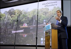 John Kerry makes a point during his speech Sunday in Jakarta, Indonesia, in which he cited a future pitted with catastrophes as a result of climate change.