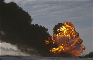 A fireball rises at the site of a derailment in Casselton, N.D. Experts said no one expected the explosive nature of the light, sweet crude from the Bakken oil field.
