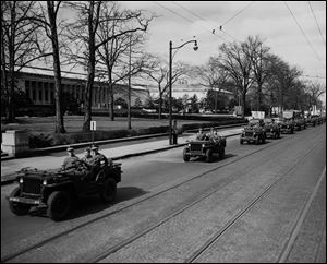 A convoy, escorted by military police, delivers the paintings to the Toledo Museum of Art in 1949 on the last stop of a U.S. tour. The museum's assistant director was among the 345 Monuments Men.