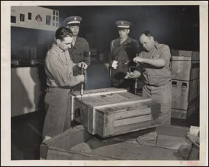 Crates are opened up under Army supervision. The paintings came from other cities in padded and heated railcars and then by truck.