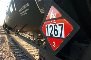 A warning placard appears on a tank car carrying crude oil near a terminal in Trenton, N.D. Experts say it's become impossible to send oil-hauling trains without passing major population centers.