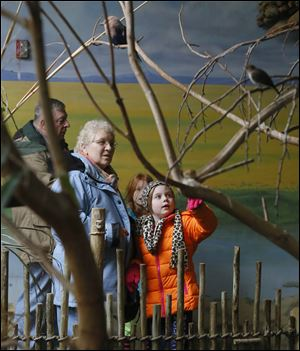 Jinnie Corthell, left, and her granddaughter Lily Hahn, 7, right;  Jim Corthell, back left, and Zoe Christian, 7, back right.