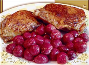 Pomegranate-glazed chicken thighs with roasted red grapes.