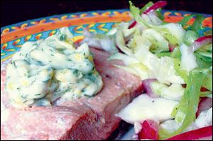 White wine-poached salmon with lemon dill mayonnaise and cabbage 'n' red onion slaw.