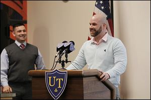Navy Reserve Lt. Heraz Ghanbari, left, and Donald Hill, a veteran and local businessman, speak at a workshop at the University of Toledo, where Lieutenant Ghanbari is the military liaison.