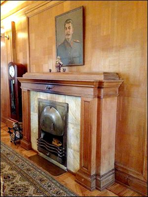 A portrait of Stalin hangs above the fireplace in his dacha in Sochi, Russia, which he built in 1936. The dictator turned the coastal town into a resort hub.