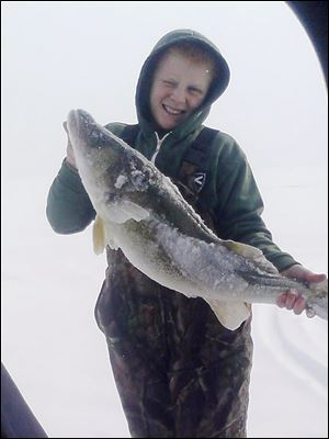 Byron Grochowski, 12, a 7th grader at Anthony Wayne Junior High, caught a 31-inch walleye recently while ice fishing on Lake Erie.