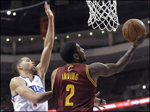 Cleveland Cavaliers' Kyrie Irving (2) drives to the basket as Philadelphia 76ers' Michael Carter-Williams defends.