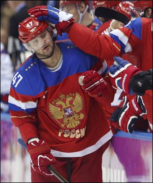 Russia forward Alexander Radulov is congratulated by teammates after scoring against Norway in the third period today in Sochi, Russia.
